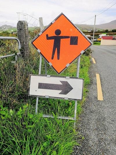 arresting road sign
